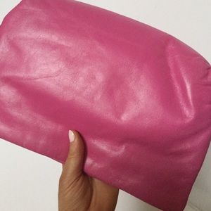 Pink zipper clutch with removable strap
